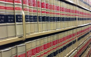 Law books representing ordinance and law regulations